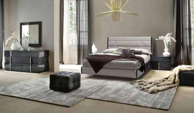 Белая современная спальня. Кроватям в стиле модерн - как правило, декоративно сдержанны.